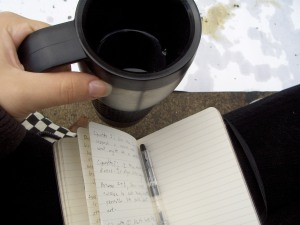 Taking notes.  Also, coffee.